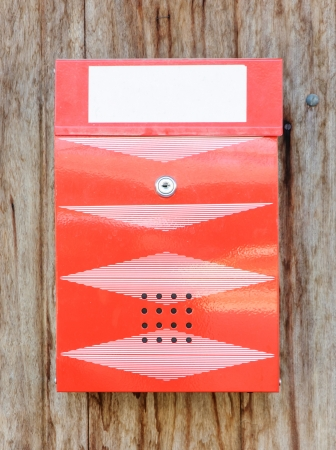 wooden post: Modern mail box of Thai post on the wooden wall