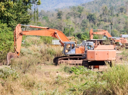 Orange excavators were parked in the construction site  photo