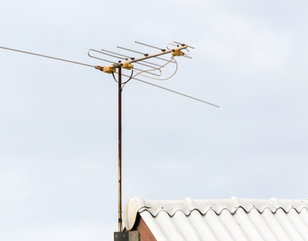 Old antenna pole on the roof of house Stock Photo - 17379289