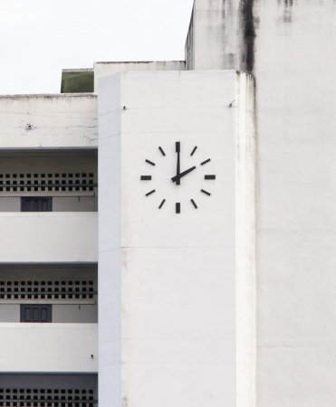 Old wall clock of the school building. photo