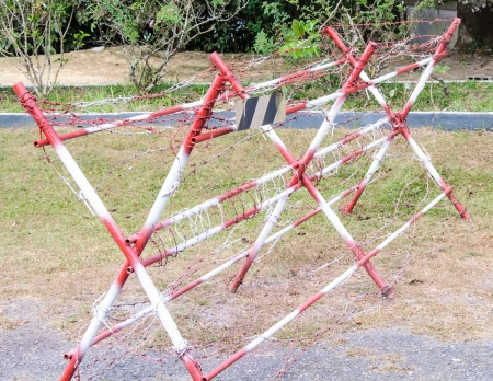 Barbed wire fence in front of the military base Stock Photo - 17717012