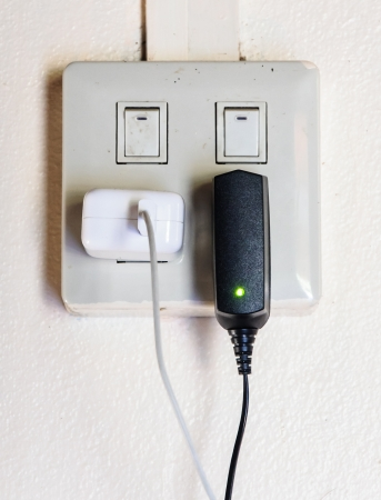 Modern wall charger for mobile device in the house