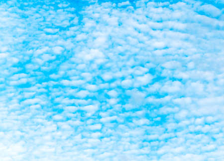 downstream: Fluffy clouds floating downstream on the blue sky