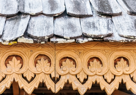 Traditional Thai stencil pattern on the wooden house. photo