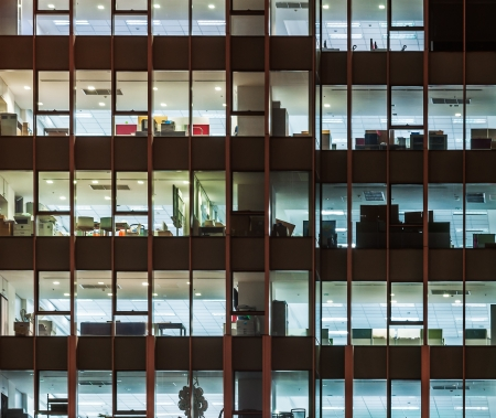 office window view: Modern office building in urban city at the night