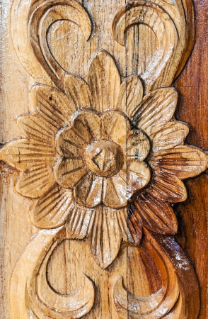 Flower motifs carved on the wooden window  Stock Photo