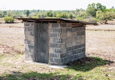 latrine: Small toilet of the farmland in countryside