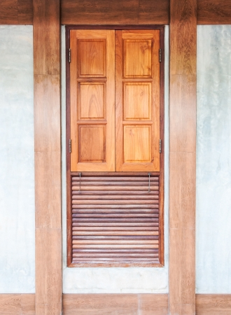 wooden window on the concrete wall in the classical house  photo