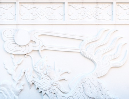 White dragons Carve on the wall of Chinese temple  photo