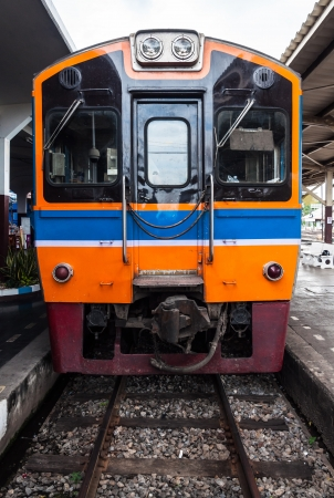 Diesel railcar for ordinary train in urban station  photo