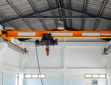 Small crane for lifting the machine in the factory  photo