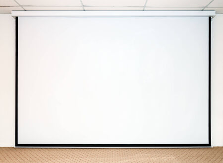 Large white screen for presentation on the stage. photo
