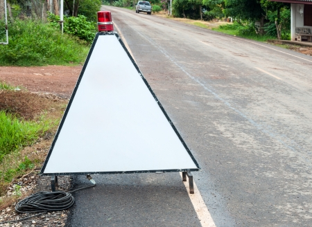 Triangle traffic stand on the countryside road  Stock Photo