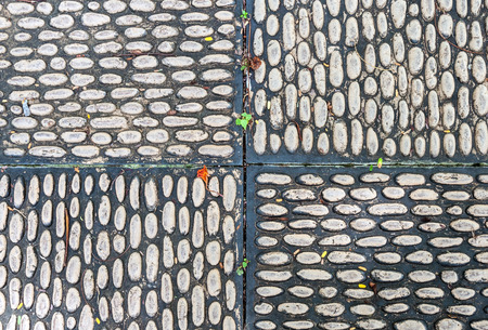 Pebble tile on the pathway of urban park  photo