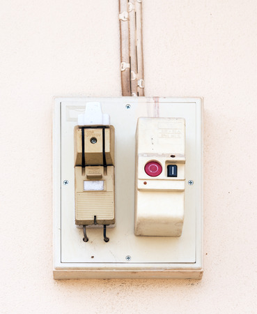 Old breaker box on the wall of urban house  photo