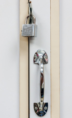 office cabinet: Security lock of wooden cabinet in the small office  Stock Photo