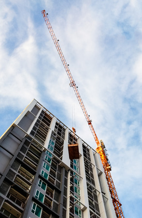 scaffolds: High carne is lifting the large tray to  modern condominium