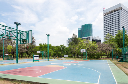 Basketball field in the city park of Thailand. photo