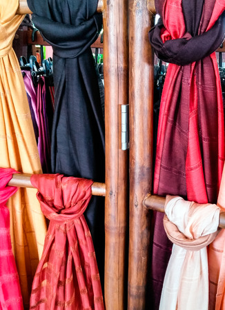 Colorful silk shawls in the Thai gift shop. photo