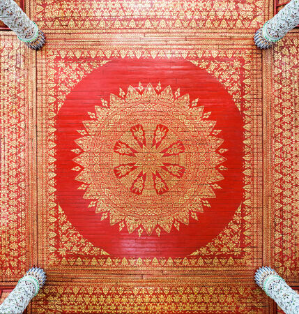 Traditional Thai ceiling on the top of Thai temple. photo