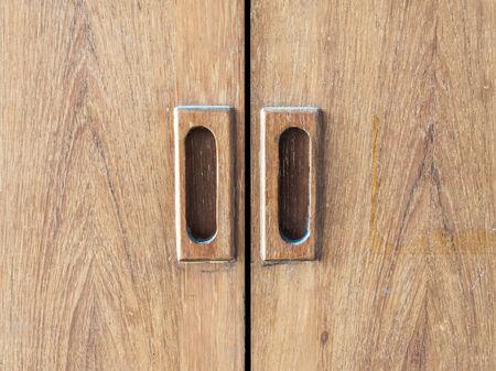 Wooden handle of old locker. photo