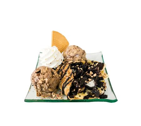 Chocolate ice cream with sofe carpe and brownie. photo