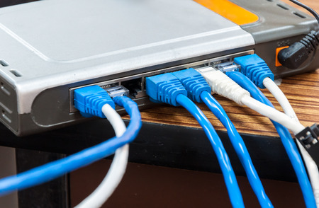 Variety of lan cable behind the modern router
