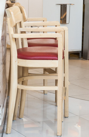 Wooden high stool for children in the restaurant. photo