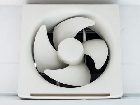 Modern plastic ventilation on the kitchen wall. photo