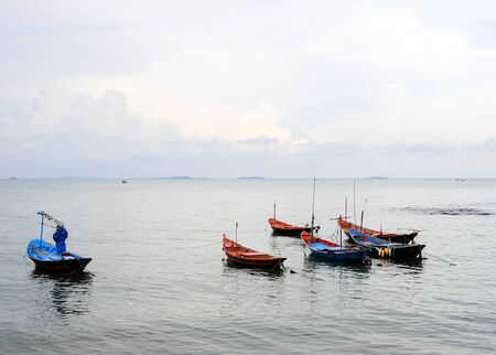 Small fishing boats near the beach in summer time. photo
