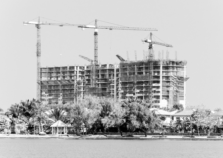 scaffolds: Construction building near the urban park.