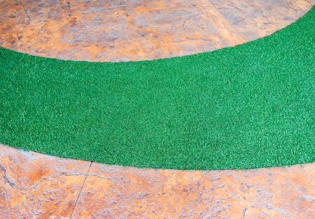 artifical: Artifical grass curve in the pathway of small garden