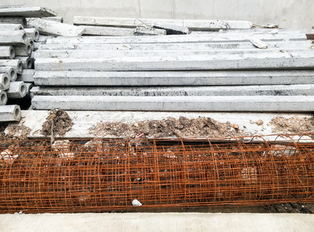 Cement column and mesh rebar in the construction site. photo
