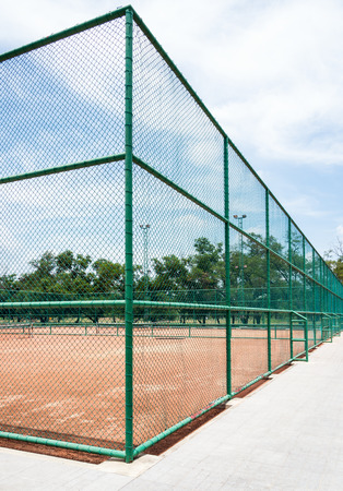 Tennis clay court in the urban park of Thailand. photo