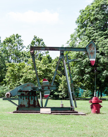 oil park: Old oil pump in the exhibition field of urban park.
