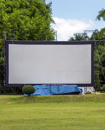 outdoor event: Large movie screen in the meadow of Thai village. Stock Photo