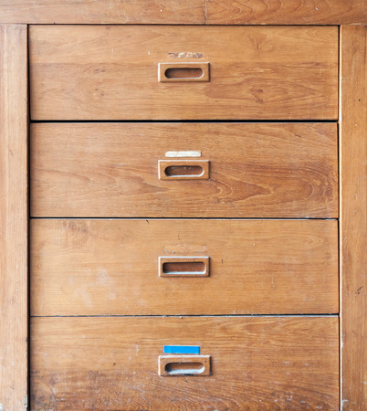 office cabinet: Wooden filing cabinet in the home office.
