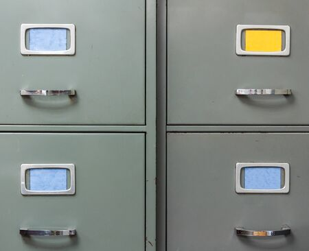filing document: Old steel filing cabinet for data document in the home office. Stock Photo