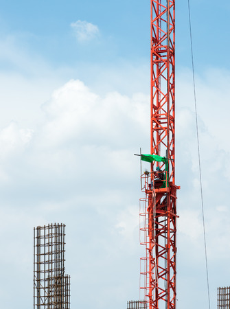 scaffolds: Control worker for construction crane  in the urban town.