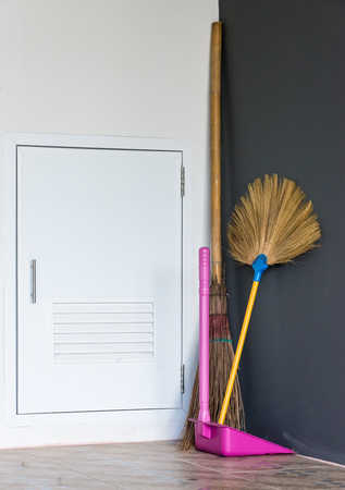 broom handle: New broom set for cleaning the house  near the storage Room.