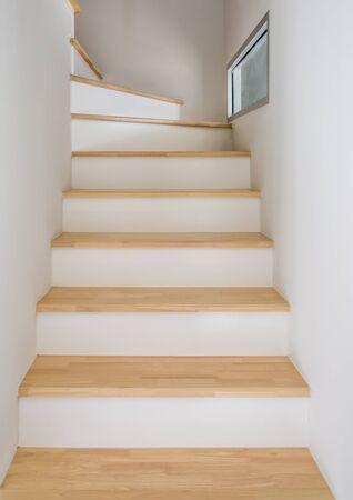 Modern wodden staircase to the top of urban house. Stok Fotoğraf