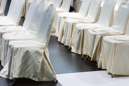 Row of white chair in the small presentaion event. Stock Photo