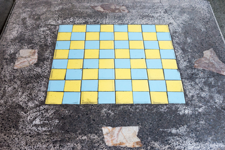 play the old park: Colorful checkerboard on the top of old marble table.