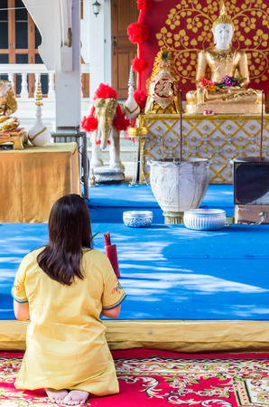 homage: Paying homage to the Buddha statue from young women in the Thai temple.