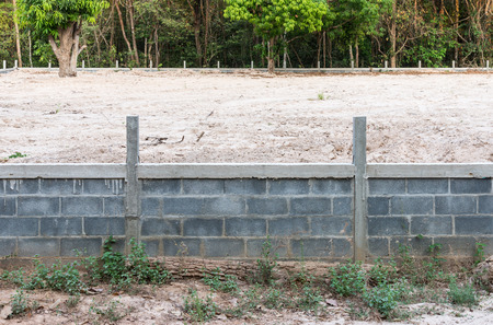 reclamation: Concrete wall with sandy soil for reclamation near the border of forest.