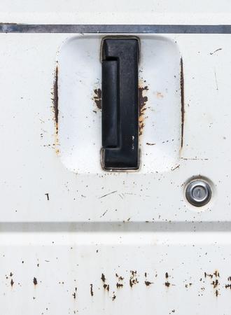 rusty car: Black handle of the old rusty car.