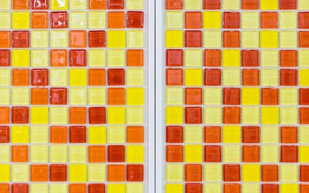 public restroom: Colorful glossy tile on the wall of public restroom. Stock Photo