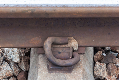 sleeper: Rusty steel peg for attach the new rail and the concrete sleeper. Stock Photo