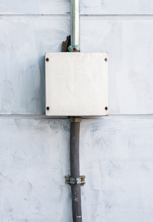 distribution board: Electrical control box on the cement wall of the factory. Stock Photo