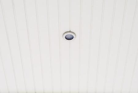 downlight: Small downlight bulb in the ceiling of relaxing room at the home office.